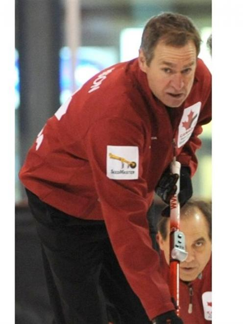 Canada's Verne Anderson in action against Hungary at the world senior curling championships in...
