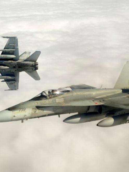 Canadian Forces CF-18 fighter jets take part in military exercises near Keflavik, Iceland. Canada...