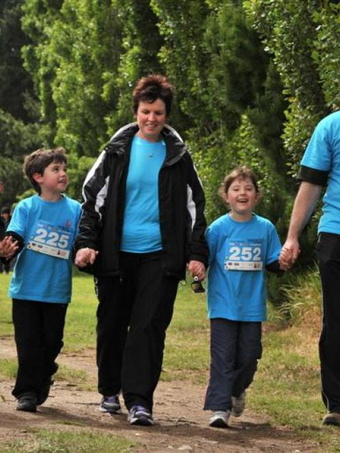 Cancer survivor Holly Bonney (7, second from right) enjoys the Child Cancer Foundation fun run...