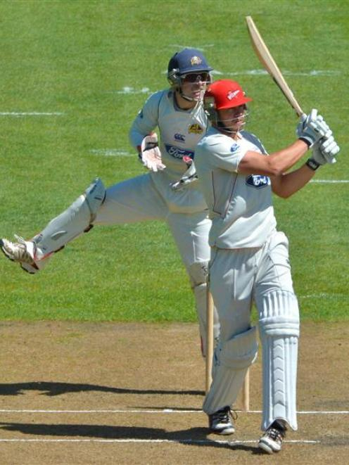 Canterbury batsman Peter Fulton plays a shot through the on side during his innings of 102 in the...