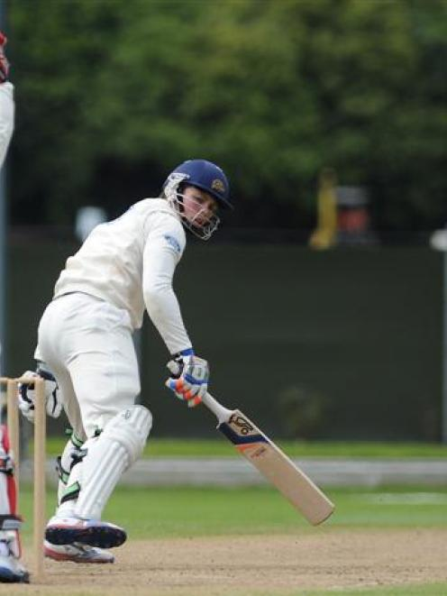 Canterbury wicket keeper Brad Cachopa (left) and bowler Cole McConchie appeal successfully to...