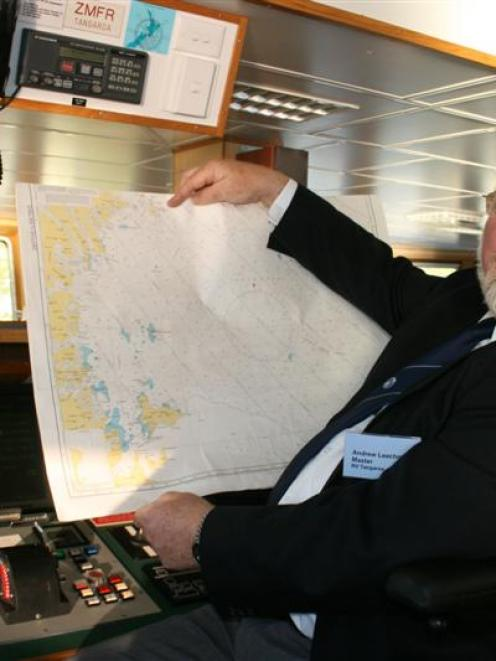Captain Andrew Leachman with a map of the Ross Sea. Photo by Nigel Benson.
