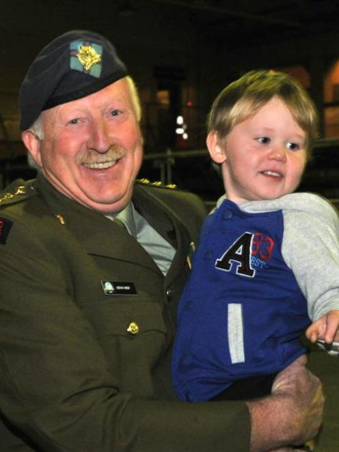 Captain Kevin Weir shares a moment with grandson Dillion  (3) after being surprised with a cadet...