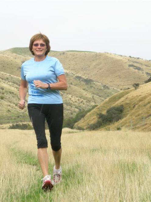 Cardrona farmer Anne Scurr (59) trains yesterday for her first marathon, the Motatapu Icebreaker,...