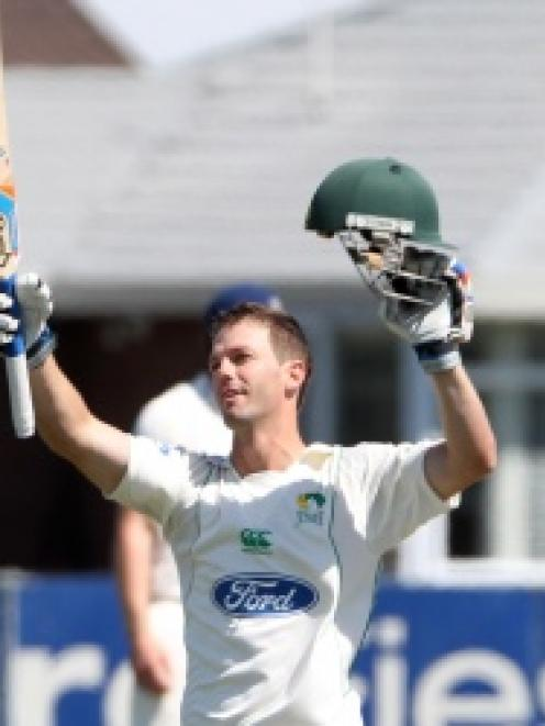Carl Cachopa gets his century at Nelson Park, Napier on Monday. Photo by Hawkes Bay Today.