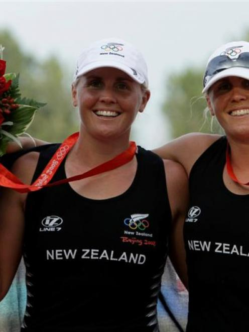Caroline and Georgina Evers-Swindell show their medals after winning the Women's double sculls...