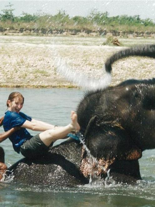 Carolyn Beaver rides an elephant in Nepal on her way to work as a vet in the UK. Photos supplied.
