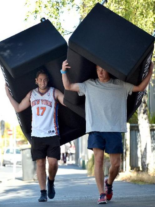 Carrying home free couches in Dunedin yesterday are Simon Early (left) and Alex Wing. Photo by...