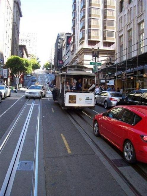 Cars and cable cars vie for their own space on a San Francisco street, this one reminiscent of...