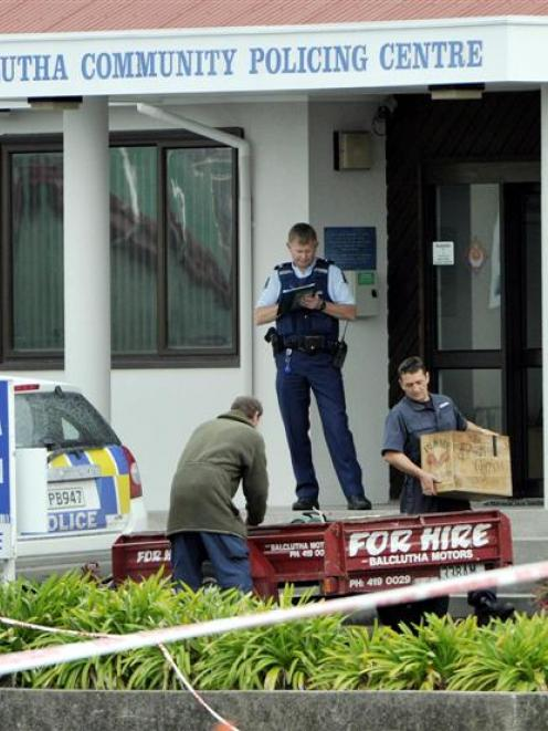 Cartons of gelignite are removed from the steps of the Balclutha Police Station.