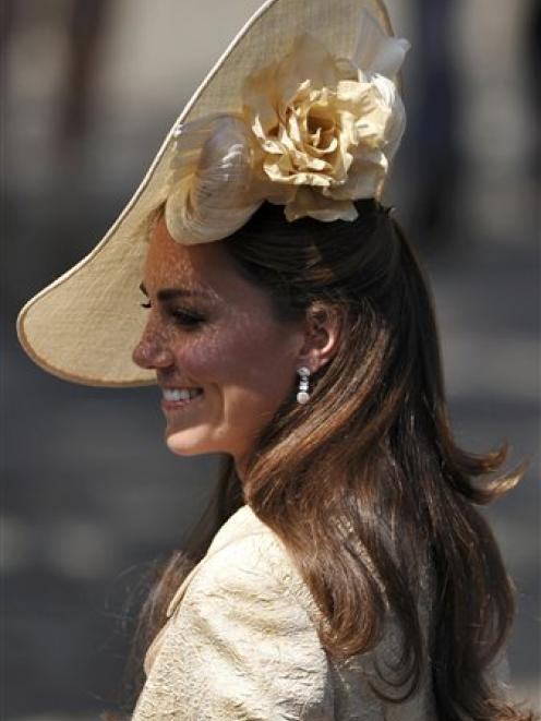 Catherine, Duchess of Cambridge, arrives for the wedding of Zara Phillips and Mike Tindall at...