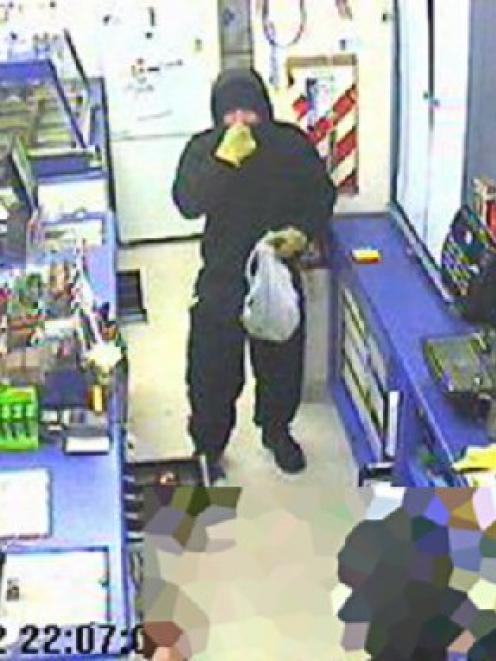 Caught on camera ... CCTV footage of the alleged assailant inside the Mornington Night 'n Day store.