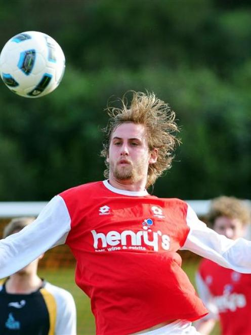 Caversham player Seamus Ryder jumps to meet the ball during his team's Chatham Cup match against...