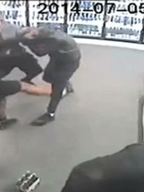 CCTV footage shows the robbery at the Thirsty Liquor store on Saturday.