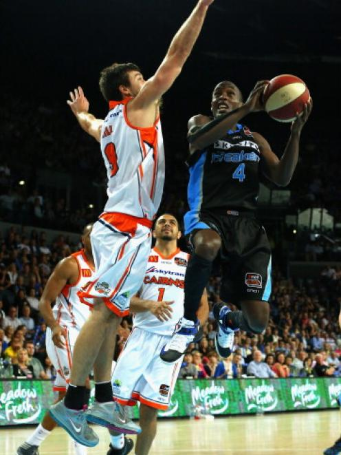 Cedric Jackson of the Breakers attacks the basket.  (Photo by Phil Walter/Getty Images)