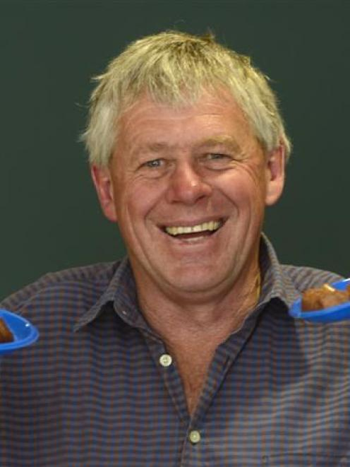 Central Otago Mayor Tony Lepper displays the dishes of venison he cooked yesterday during the ...