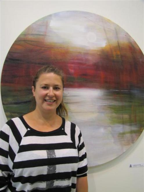 Central Stories Museum and Art Gallery project manager Rachel Checketts stands with Reflections...