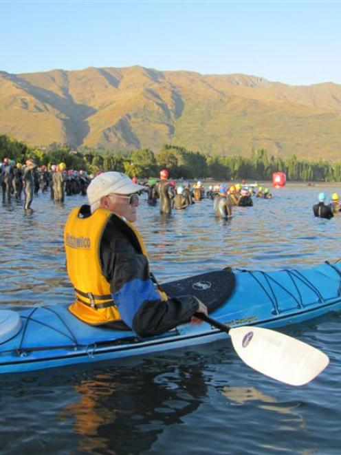 Challenge volunteer John Darby watches the swimmers from his kayak. Photos by Mark Price.
