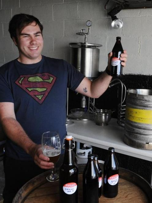 Champion home-brewer Brendan Bransgrove checks the quality of his award-winning Little Jimi...