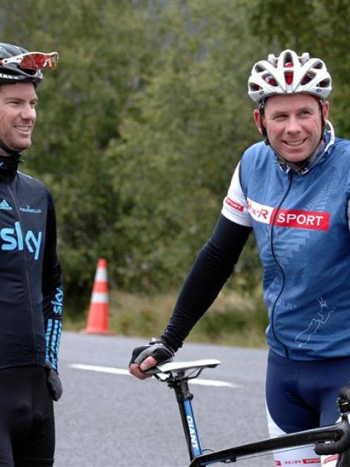 Champion international cyclist Greg Henderson (left) talks with the president of Cycling Otago,...