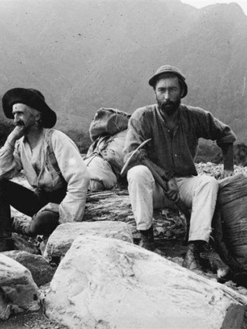 Charles Edward Douglas and Arthur Paul Harper in the valley of the Cook River, 1894, with ...