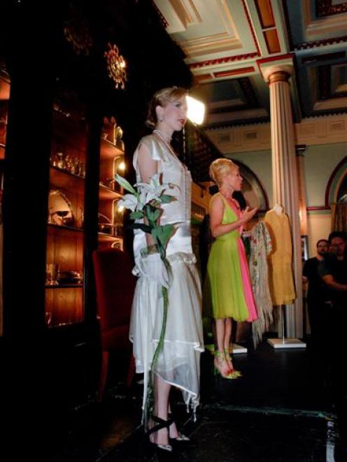Charlotte Smith on stage with one of her models at an Agatha Christie fashion show she staged...
