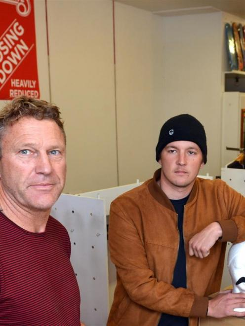 Cheapskates Dunedin co-owner Mark Browne (left) and manager Chris Stephenson pack up stock from...