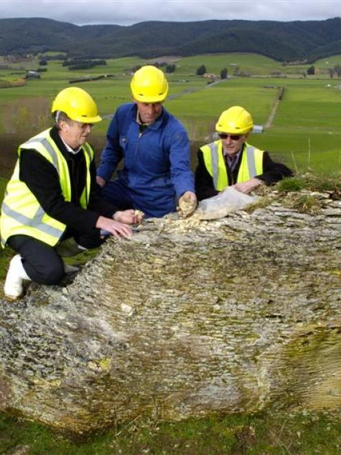 Checking phosphate samples at Clarendon, in South Otago, are (from left), Ravensdown chief...