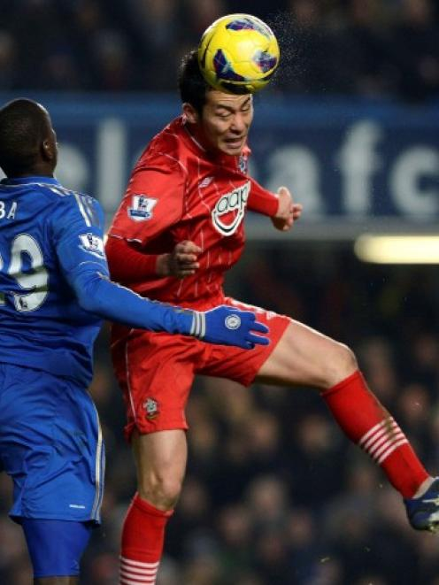 Chelsea's Demba Ba (L) challenges Southampton's Maya Yoshida during their English Premier League...