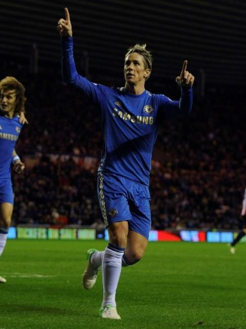 Chelsea's Fernando Torres (2nd L) celebrates scoring a penalty against Sunderland during their...