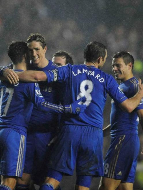 Chelsea's Fernando Torres (2nd L) celebrates scoring against Leeds United during their English...