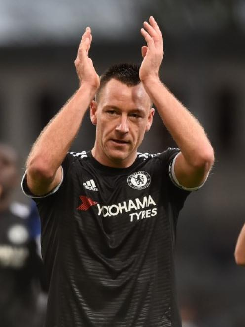 Chelsea's John Terry applauds fans at the end of the match. Photo: Reuters