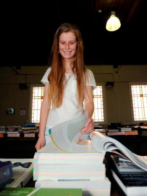 Chemistry student Ella Frawley (19) has a look through a textbook at the Student Christian...