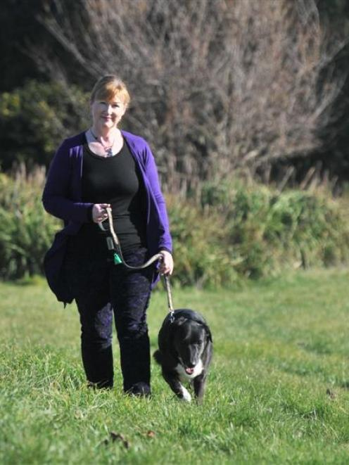 Cheryl Pearson, of East Taieri, walks dog Lucy on the Elizabeth Ave land where she wants an...