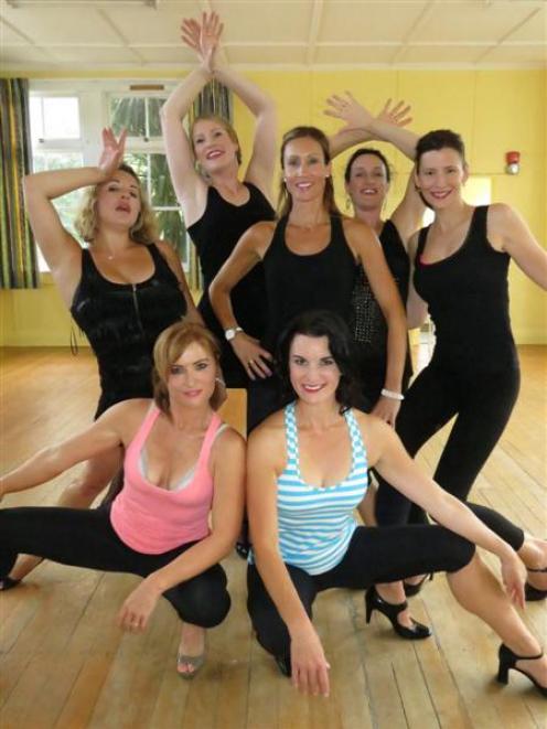 Chicago hopefuls (from back left) Lauren Veneziano and Zelia Horrell, both of Queenstown, with...
