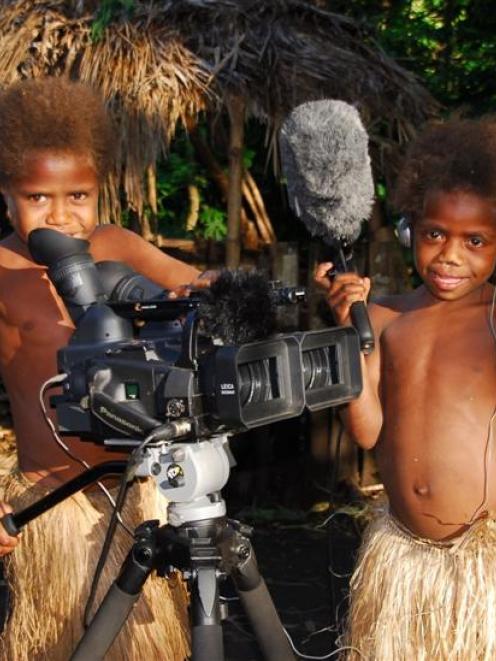 Children embrace 3-D technology in Yakel Village.