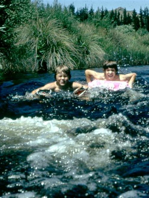 Children enjoy the clear waters of Deep Stream in the 1970s. Photo by Donald Scott.