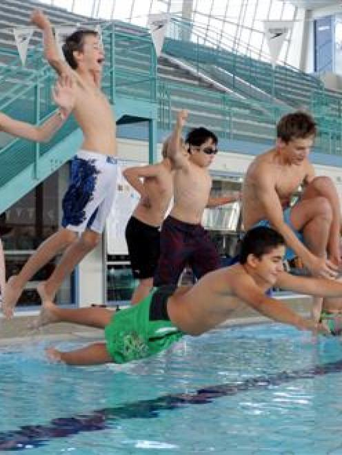 Vienna Boys Choir members get up to hijinks  at Moana Pool yesterday. Photo by Craig Baxter.