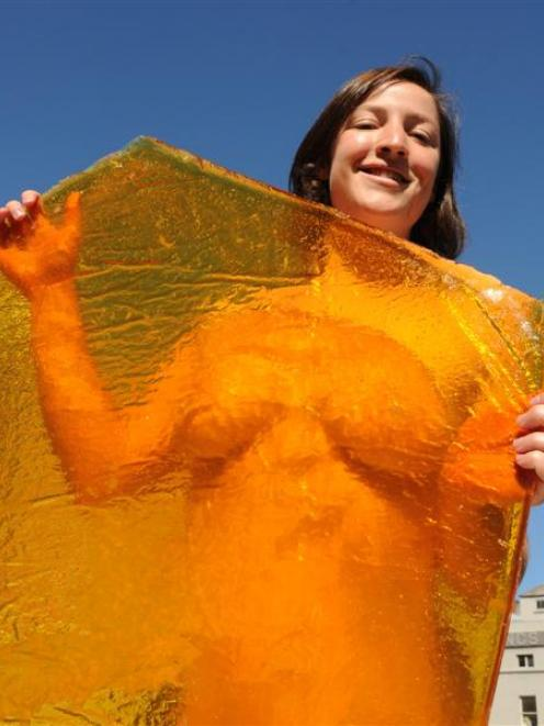 Christchurch artist Audrey Baldwin yesterday stands behind one of the panes of toffee that will...