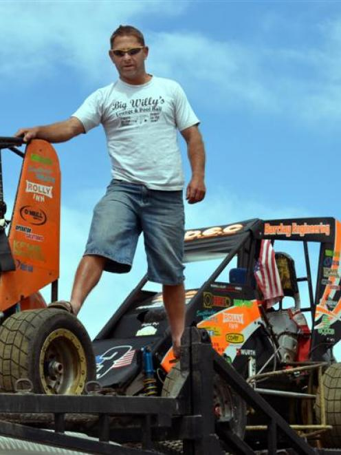 Christchurch driver David Ferguson checks out his cargo of TQ racing cars after arriving in...
