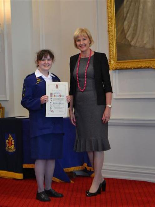 Christy Nicholls is all smiles after being presented with her Queen's Award certificate by Janine...