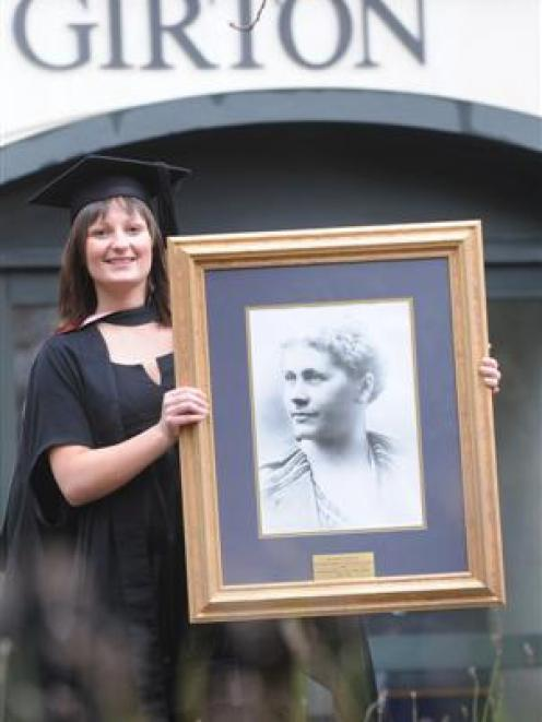 Claire Steele, of Wellington, who graduates from the University of Otago today, holds a...