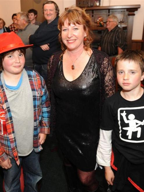 Clare Curran with sons Callum (left) and Riley on Saturday night. Photo by Craig Baxter.