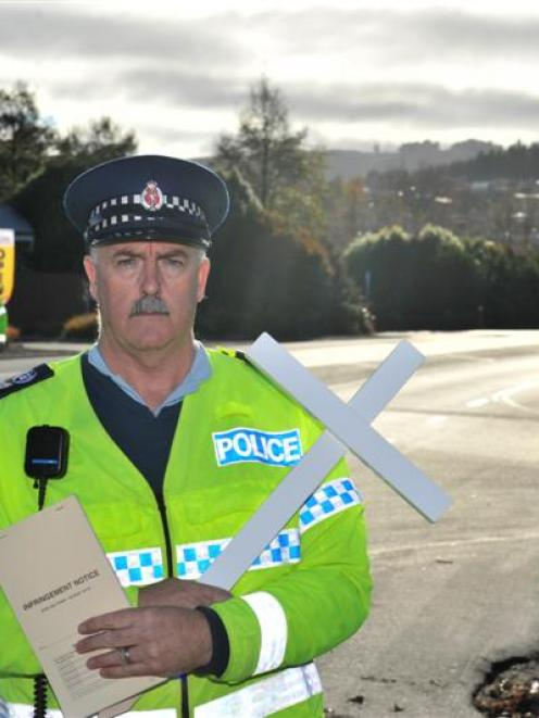 Clutha-Taieri area response manager Senior Sergeant Al Dickie gets his message across at a...
