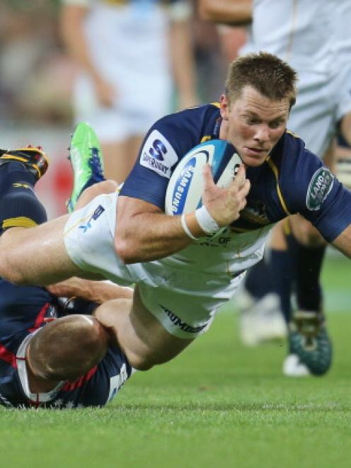 Clyde Rathbone of the Brumbies is tackled by James O'Connor of the Rebels during their match at...