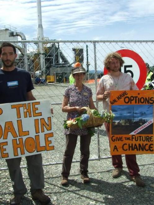 Coal Action Network Aotearoa member Rosemary Penwarden (centre) flanked by Jeanlou Fourquet (left...