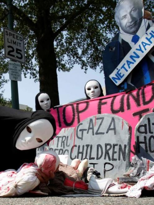 Codepink activists, dressed to symbolise those wounded and killed in Gaza, rally outside the...