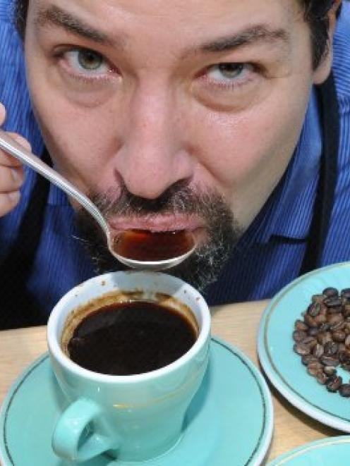 Coffee researcher Mario Fernandez appraises another cup of coffee. Photo by Jane Dawber.