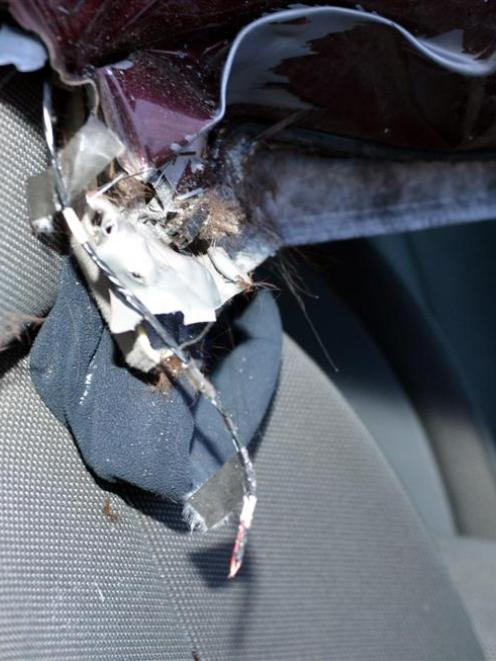Colin Tumaru's beanie remains pinned between the car roof and driver's seat after the crash.