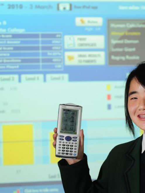Columba College pupil Monica Bae with a touch-screen algebraic simulating calculator she won...